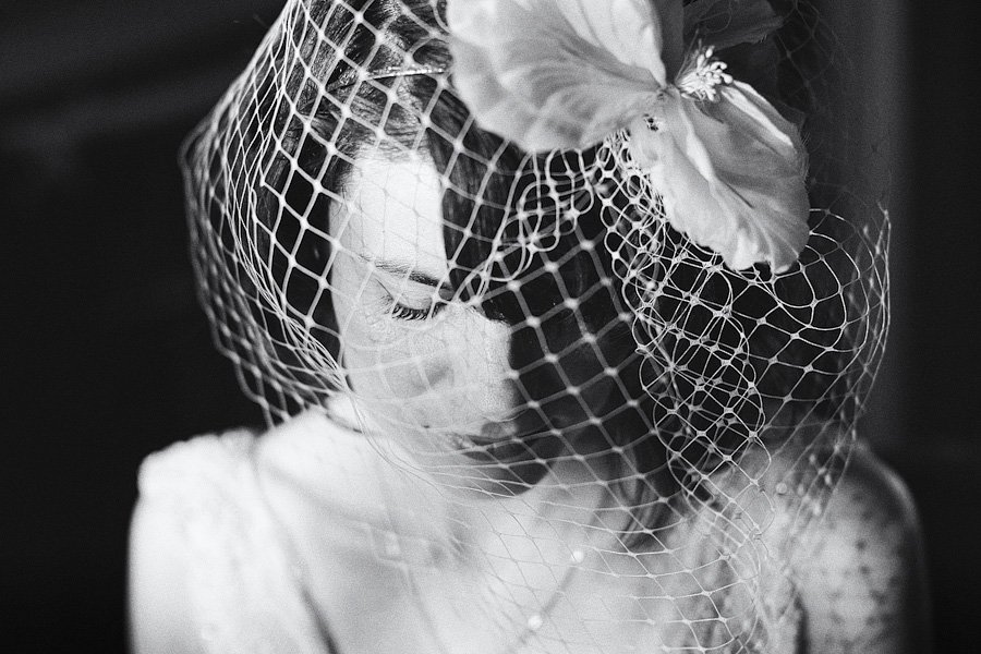 Bride in Birdcage veil before Scarborough Registry Office wedding. Black & White wedding photograph