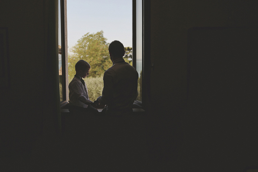 silhouette of boy and father