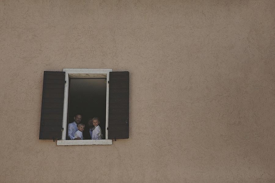 family in window in lake garda