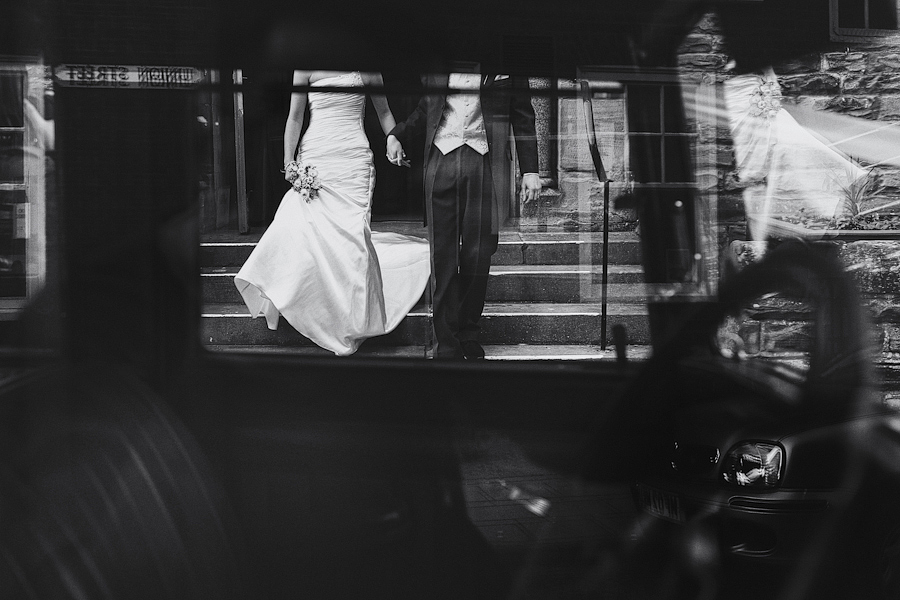 Alternative angle of bride and groom leaving church