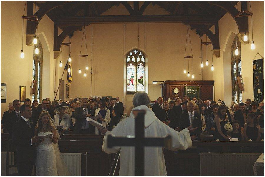 Vicar-preaching-to-service