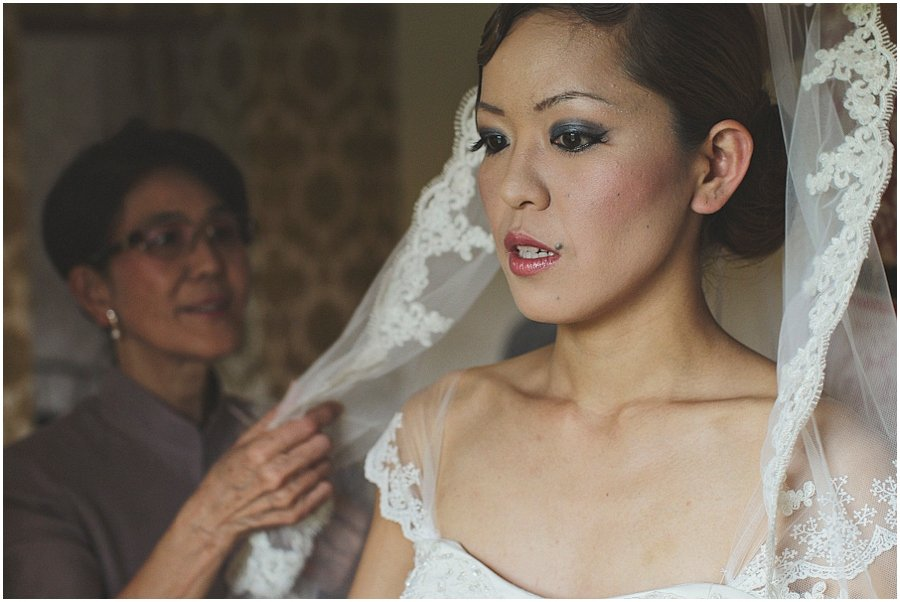 Bride getting ready in dress at Ox Pasture Hall