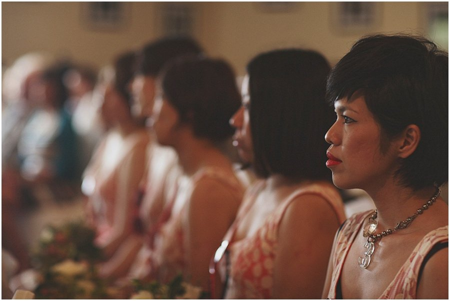 Bridesmaids watching ceremony at Ox Pasture Hall