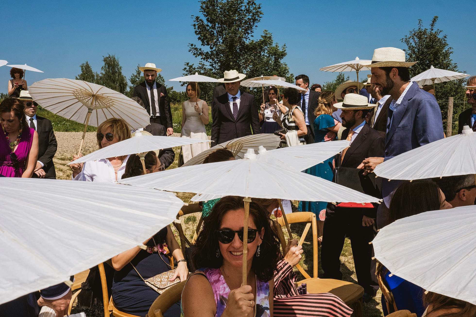 Wedding Guests with Sun Umbrellas