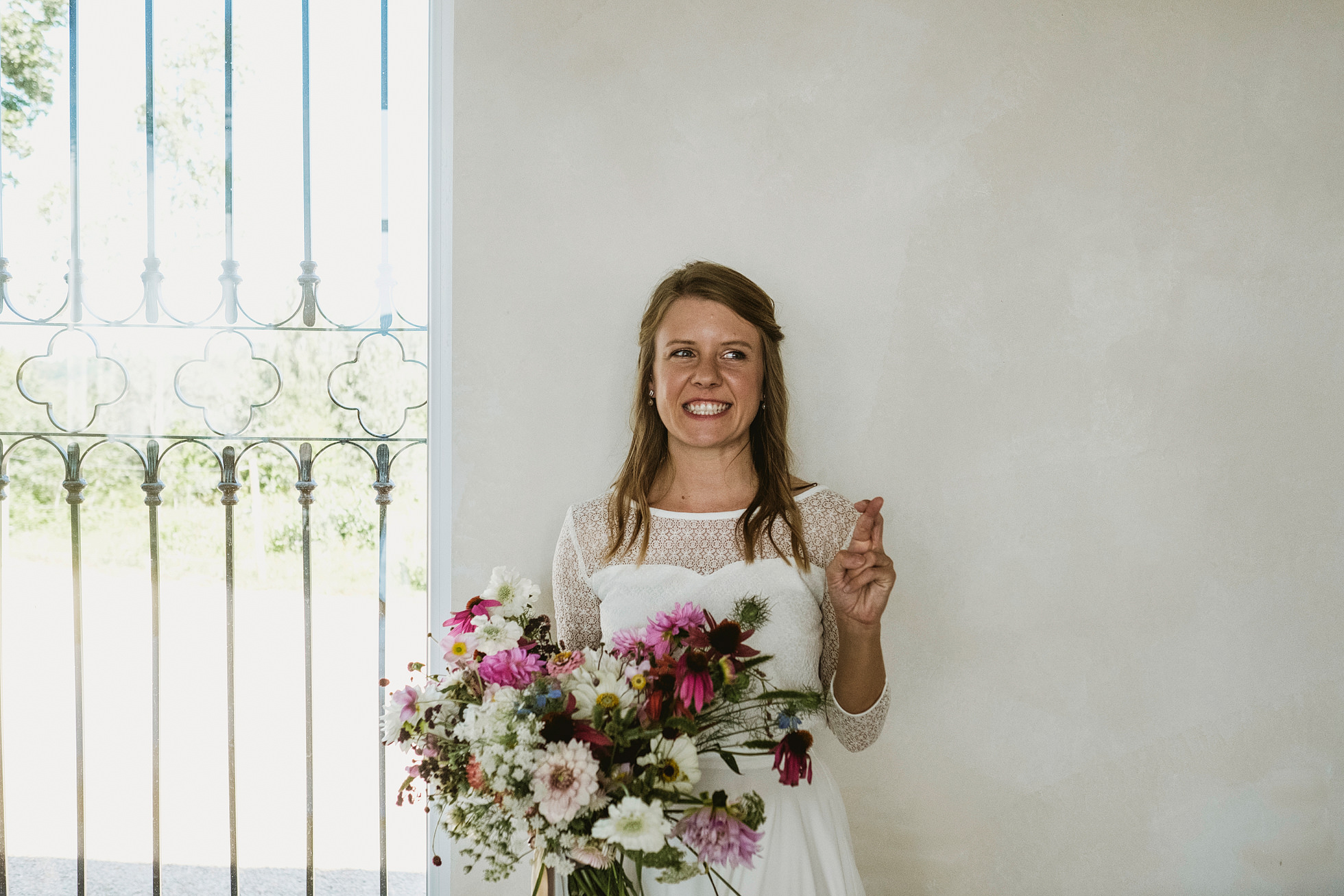 Bride with fingers crossed - Villa Love Krakow