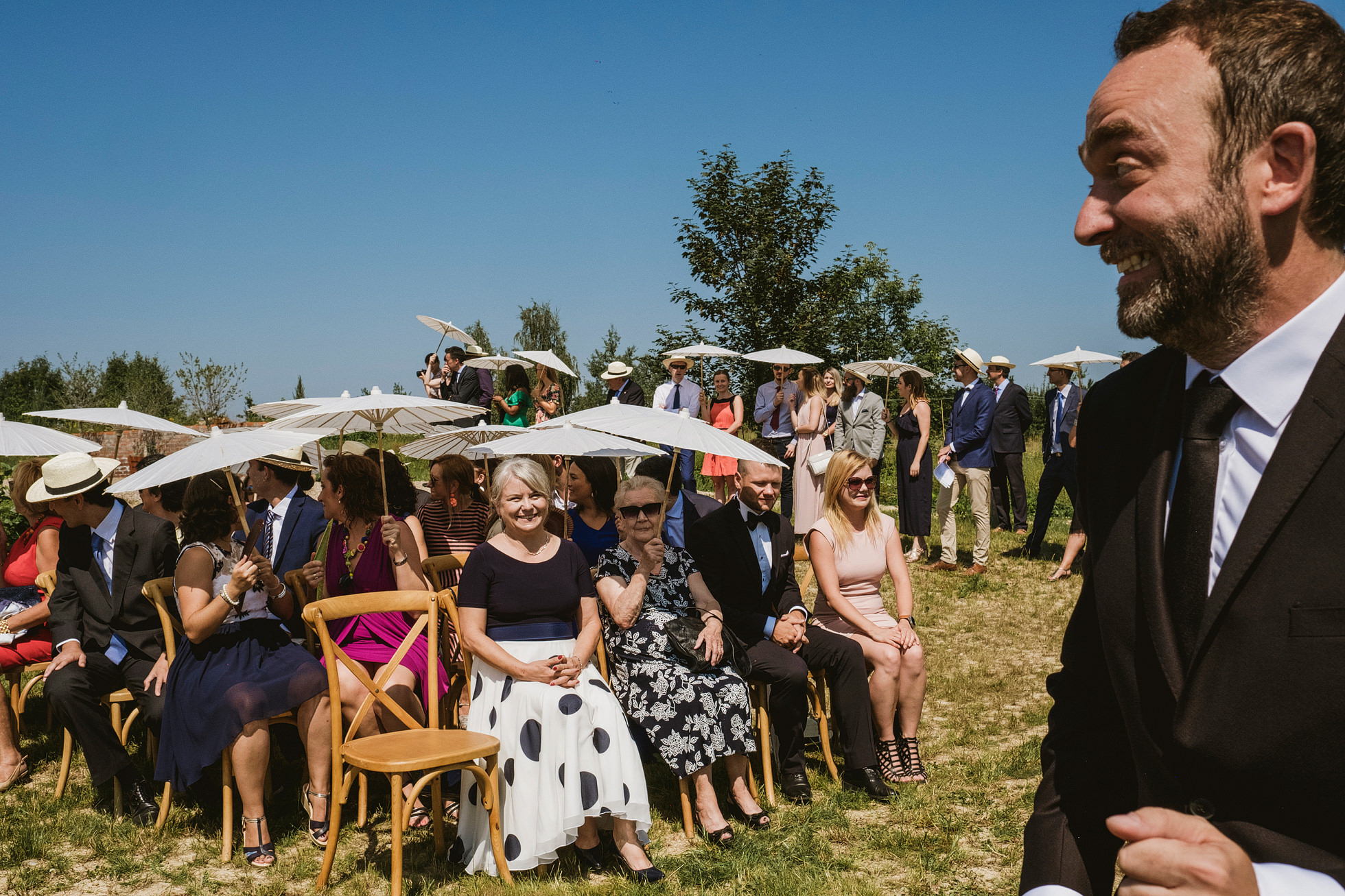 Excited groom at outdoor wedding ceremony in Krakow