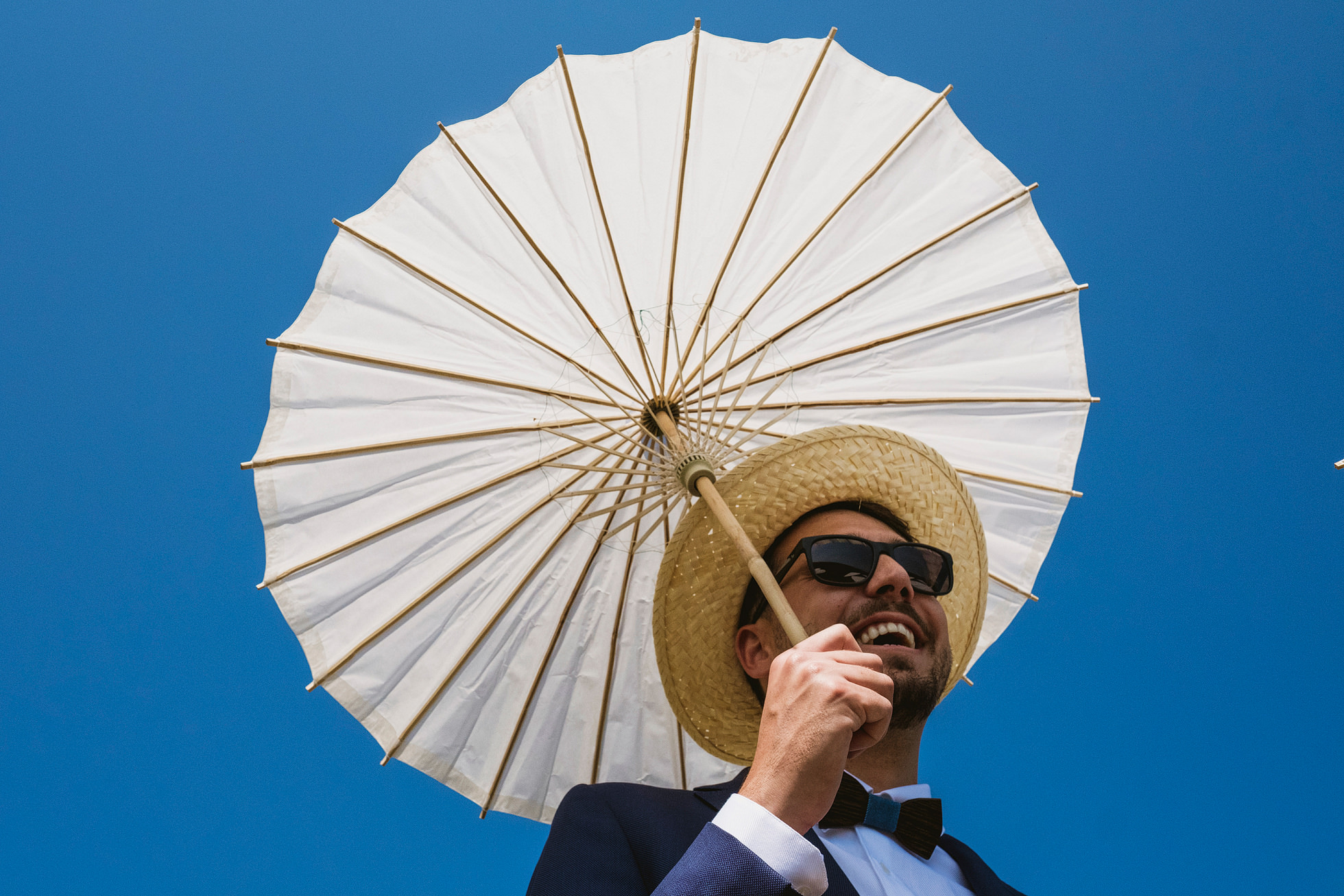 Polish groomsman with sun umbrella