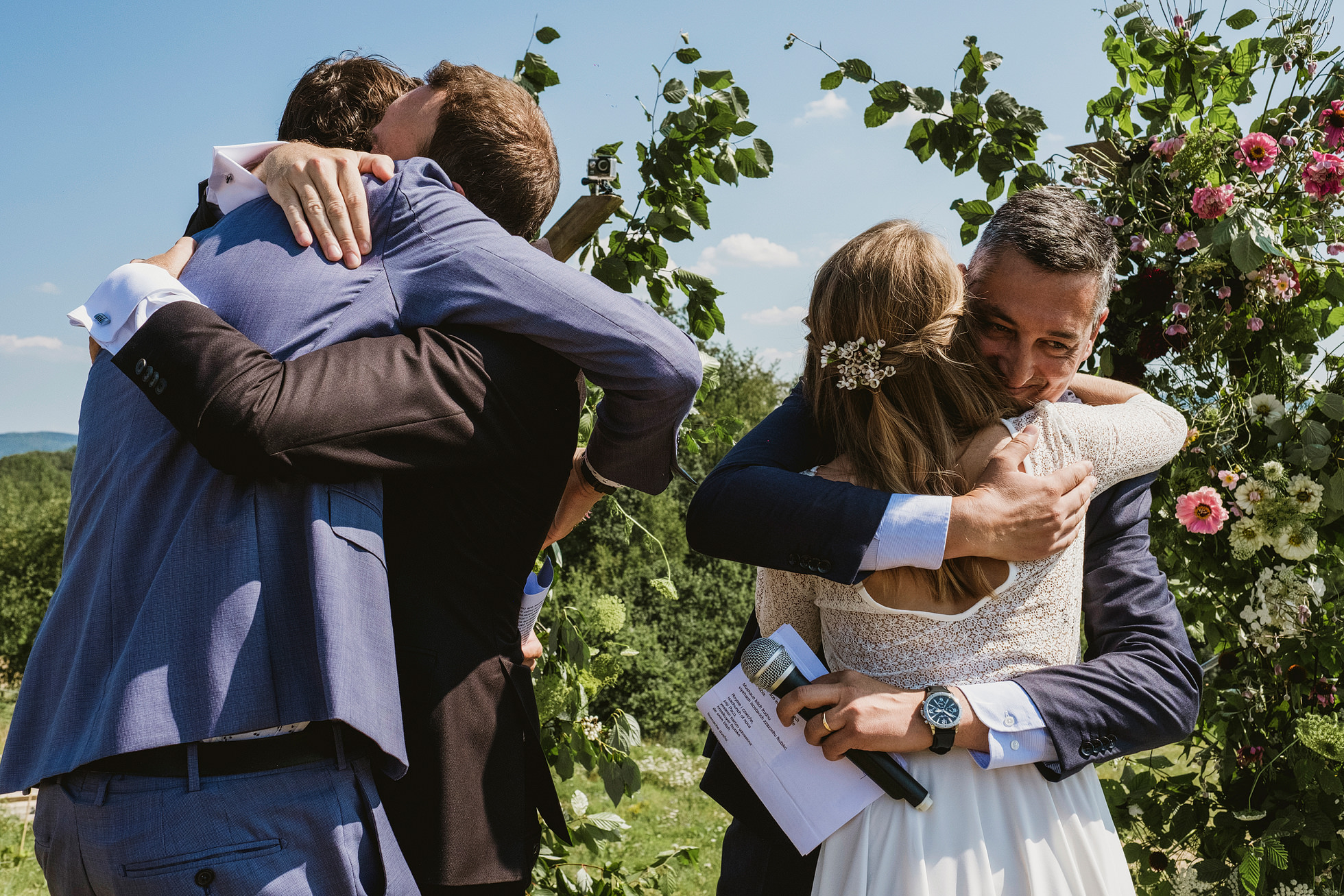Bride and groom hugs after readings at Villa Love wedding ceremony