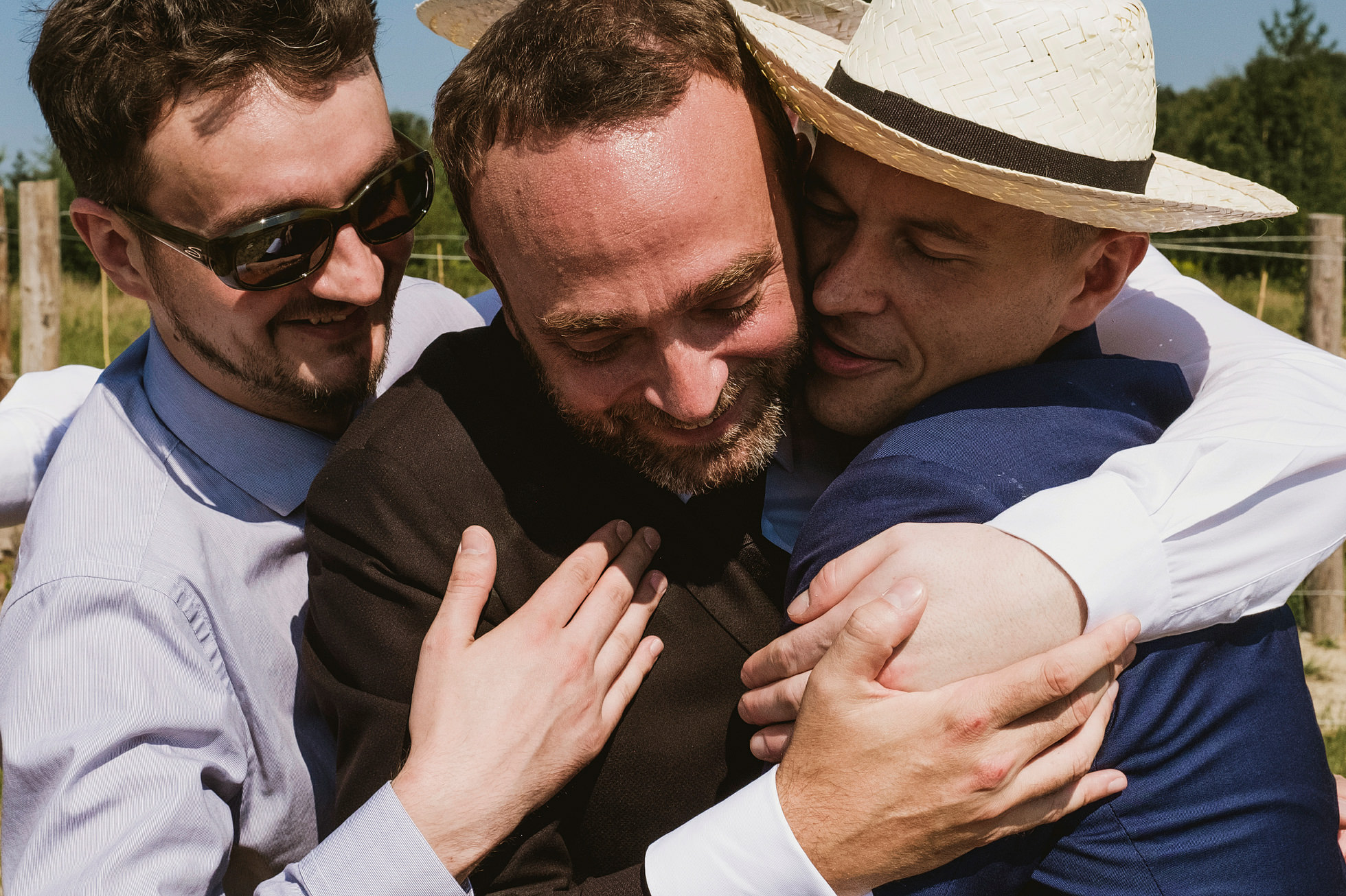 Men hugging at Krakow wedding