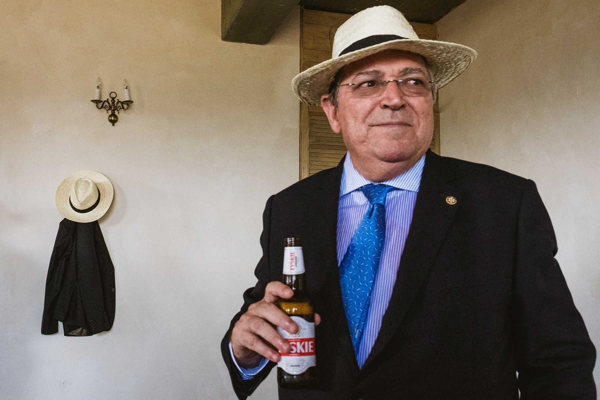 Wedding guest with beer wearing Polish straw hat