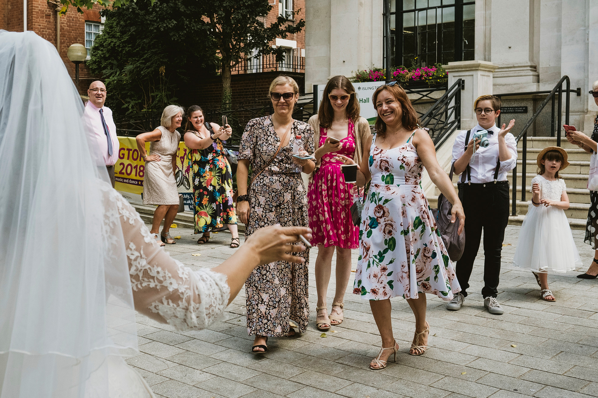 Bride meeting guests, Islington Town Hall