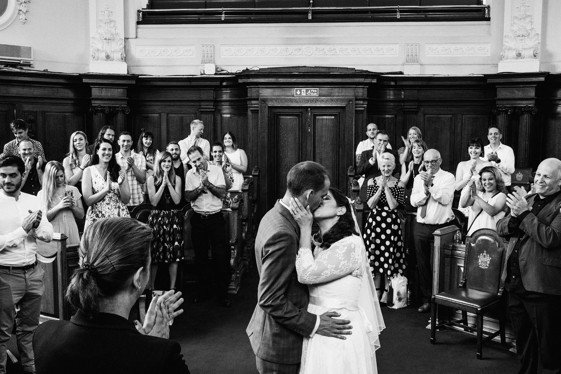 First kiss wedding photograph