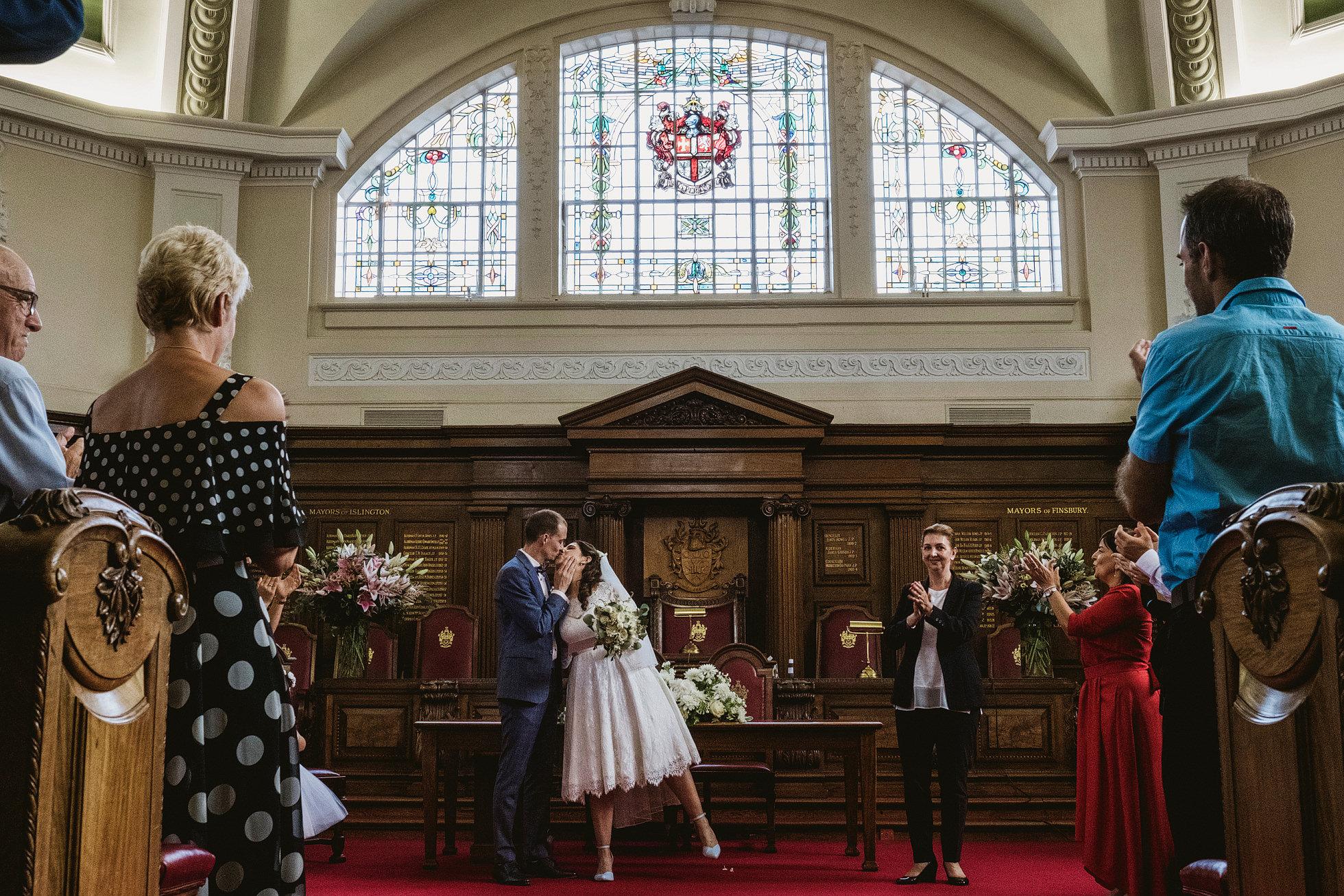 Islington Town Hall Wedding Photography - bride and groom kiss