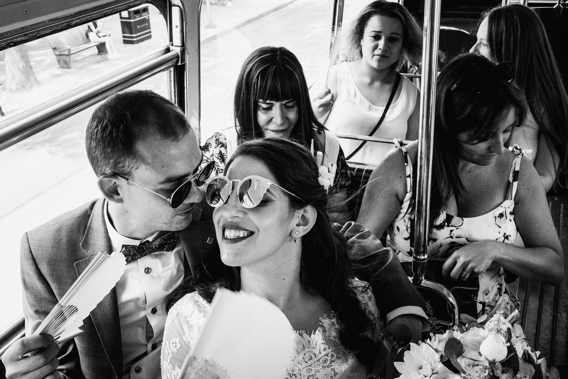 Bride and groom on London Red Bus