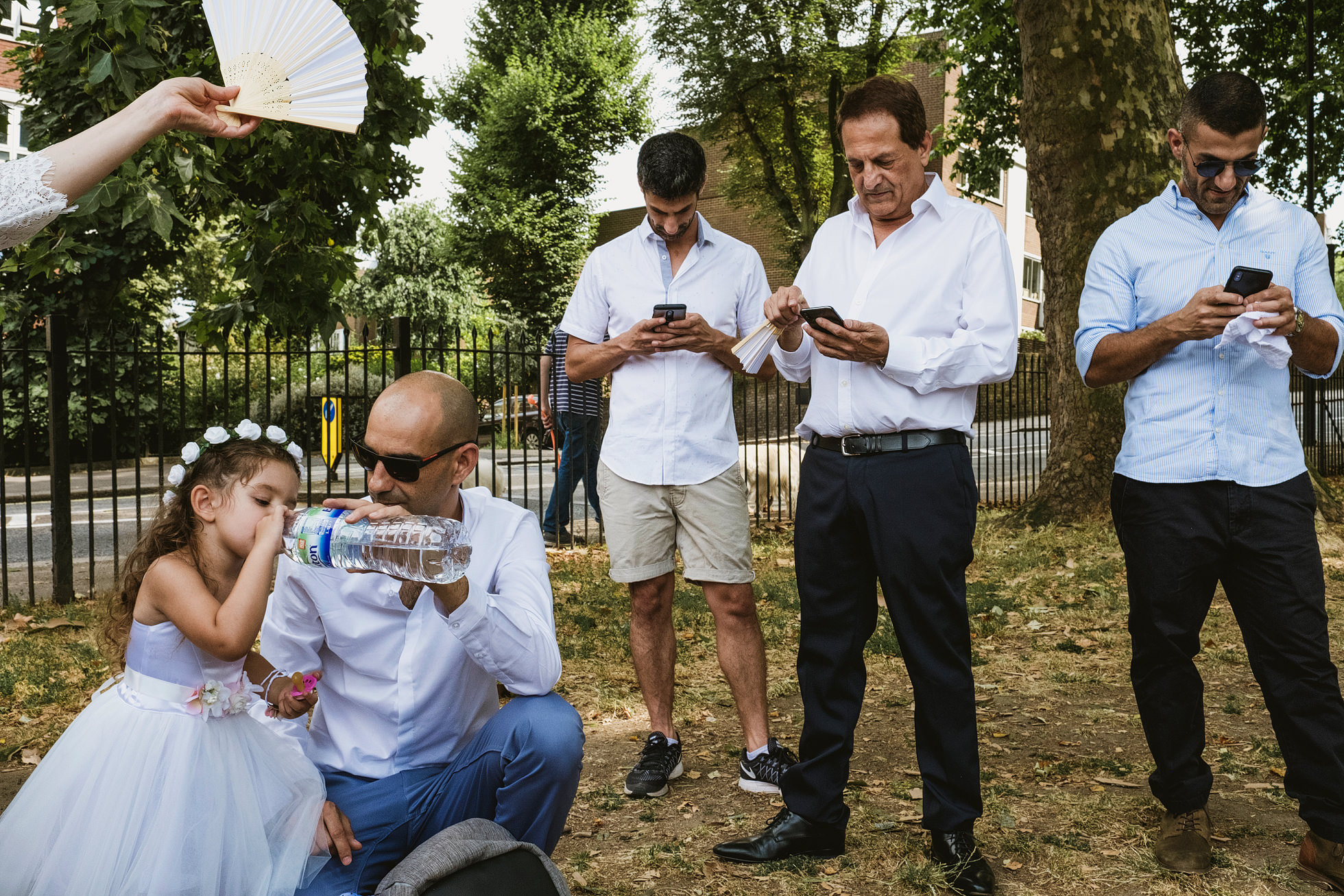 Guests texting at weddings, Islington Wedding Photographers
