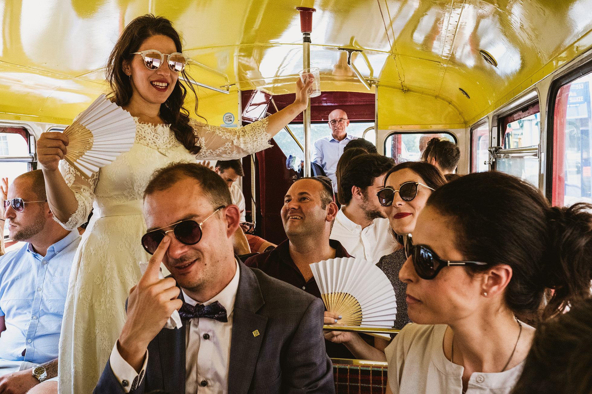 Bride and groom on bus wedding photograph
